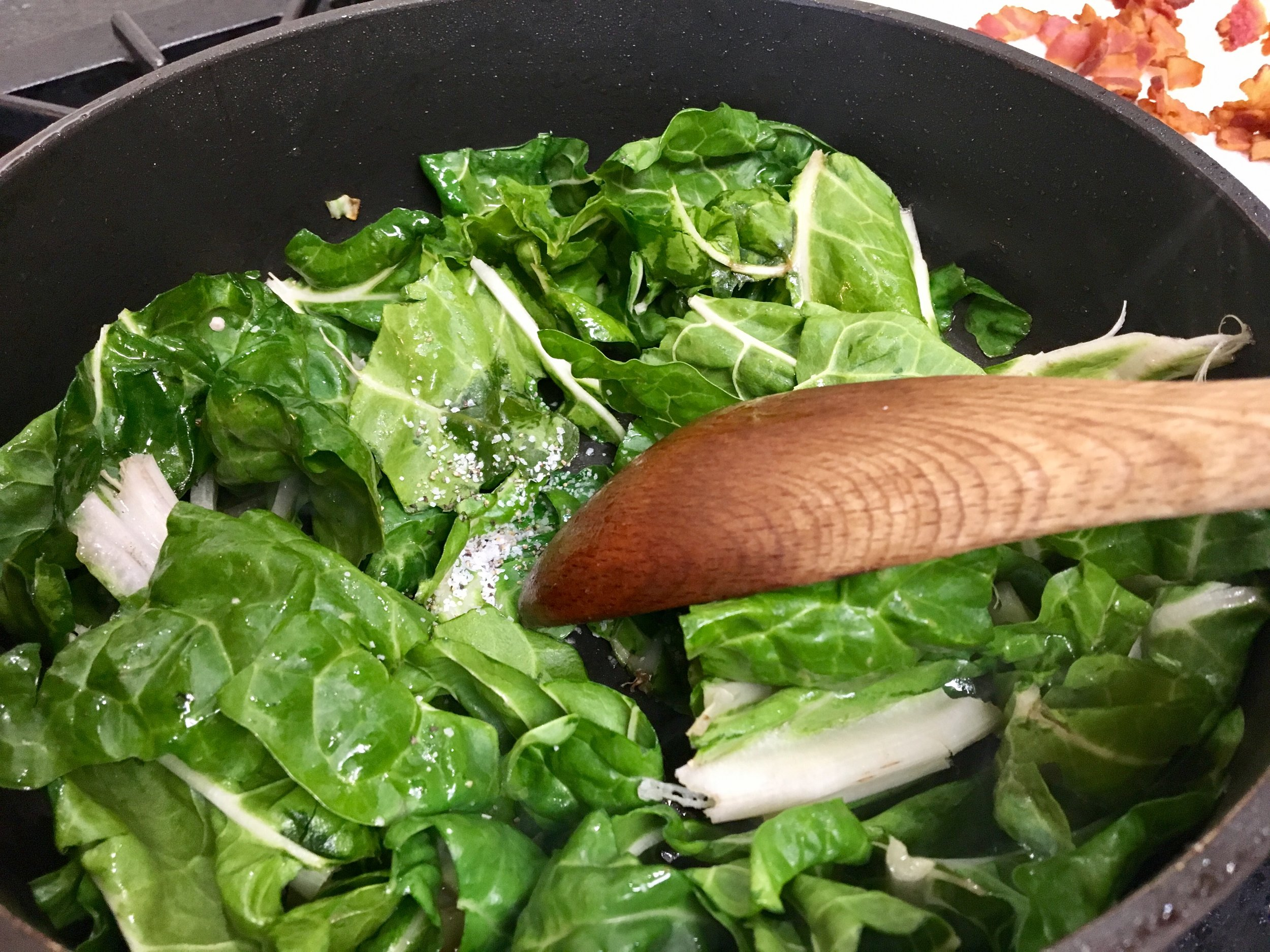 Wilting the Swiss Chard with the bacon drippings.