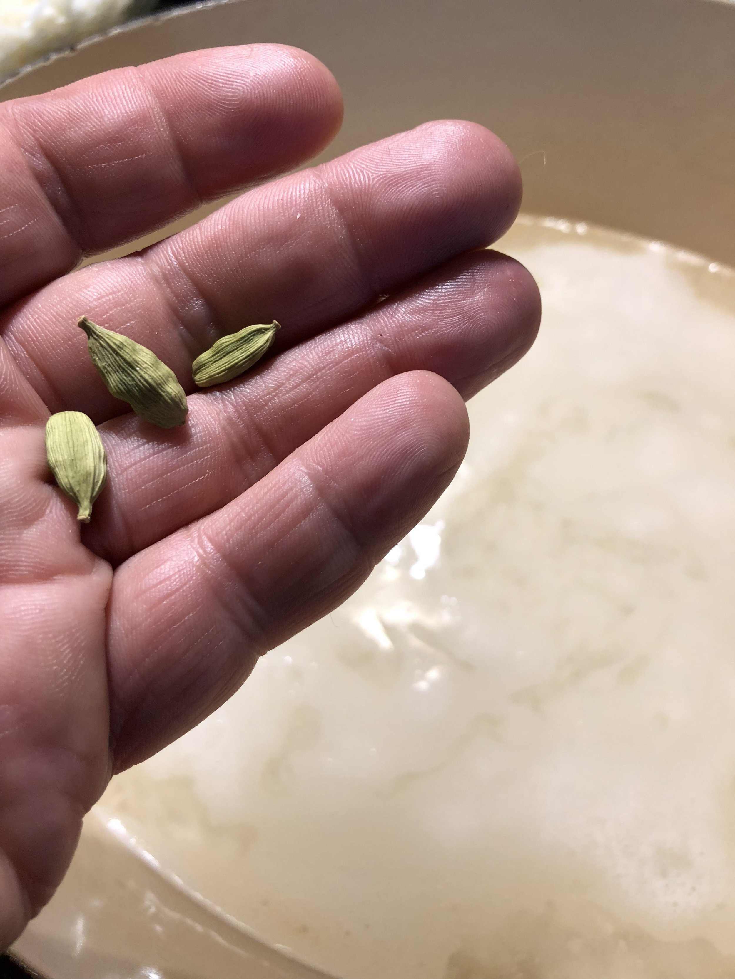 Cardamom pods. The green things... not my chubby fingers.