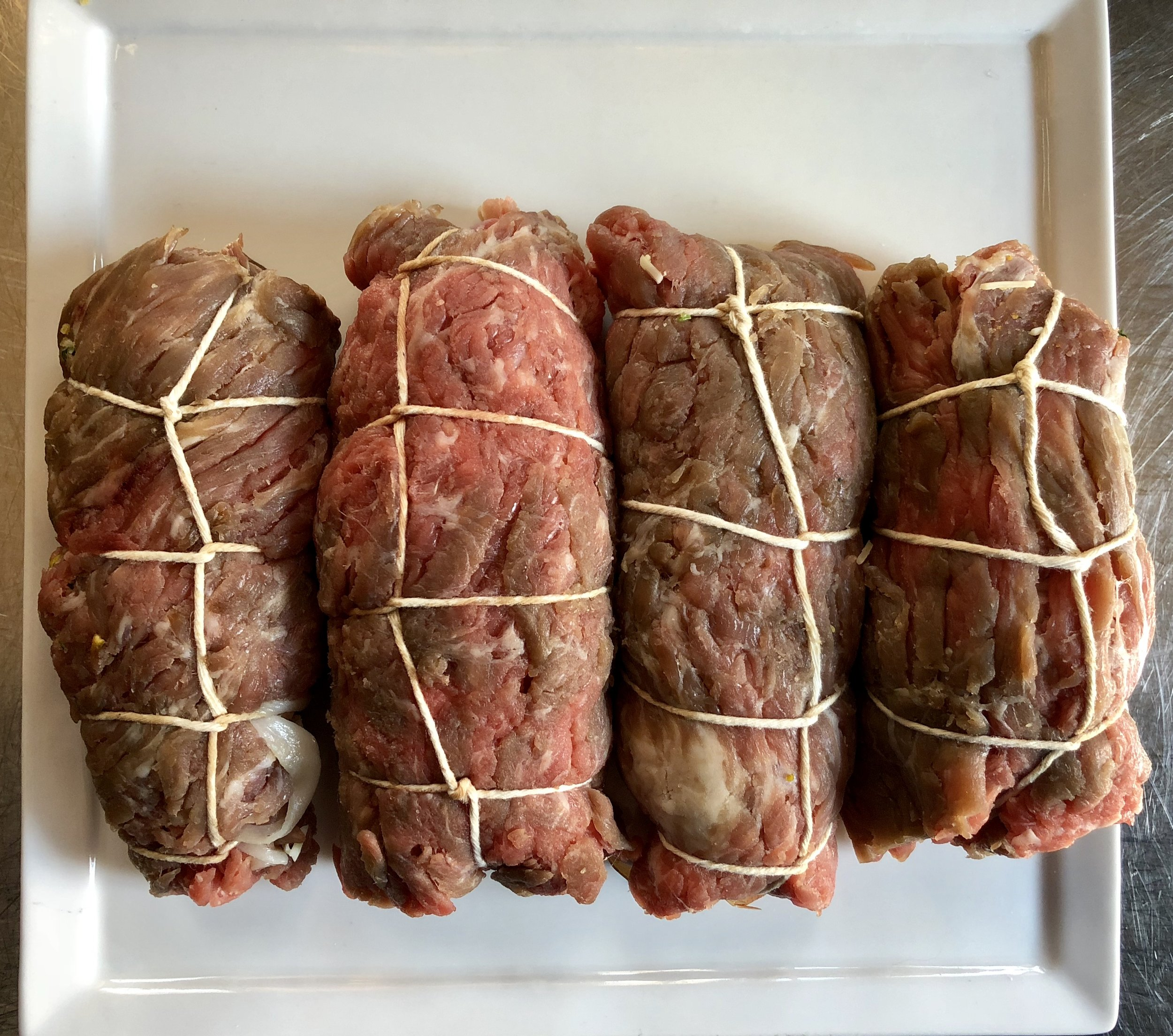 Rolled, tied, and ready to be seared.