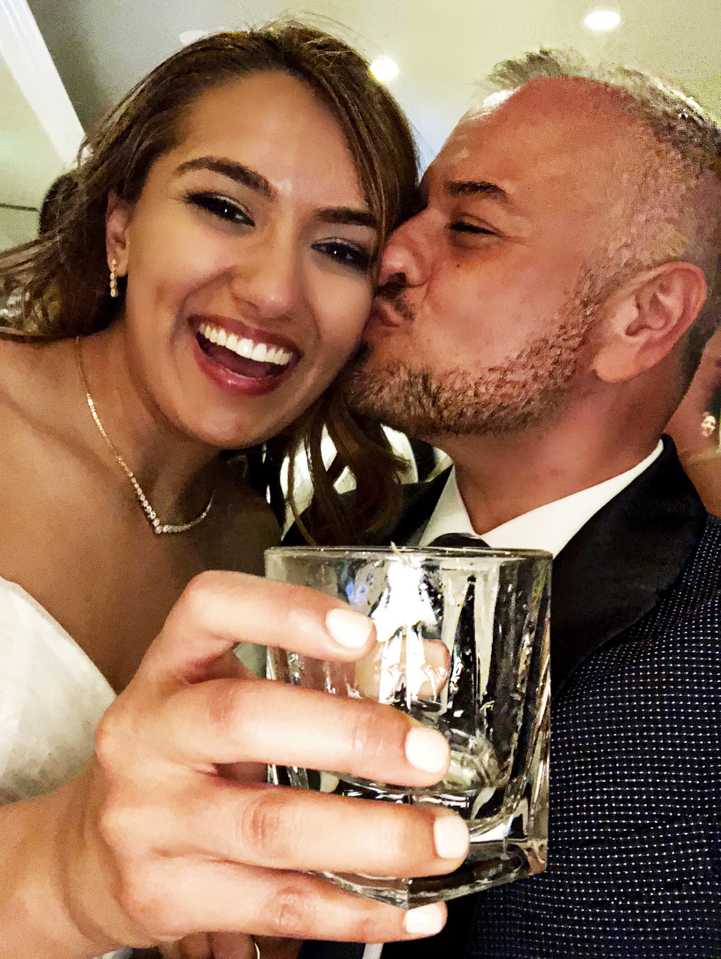 Kissing the beautiful bride! Cheers!