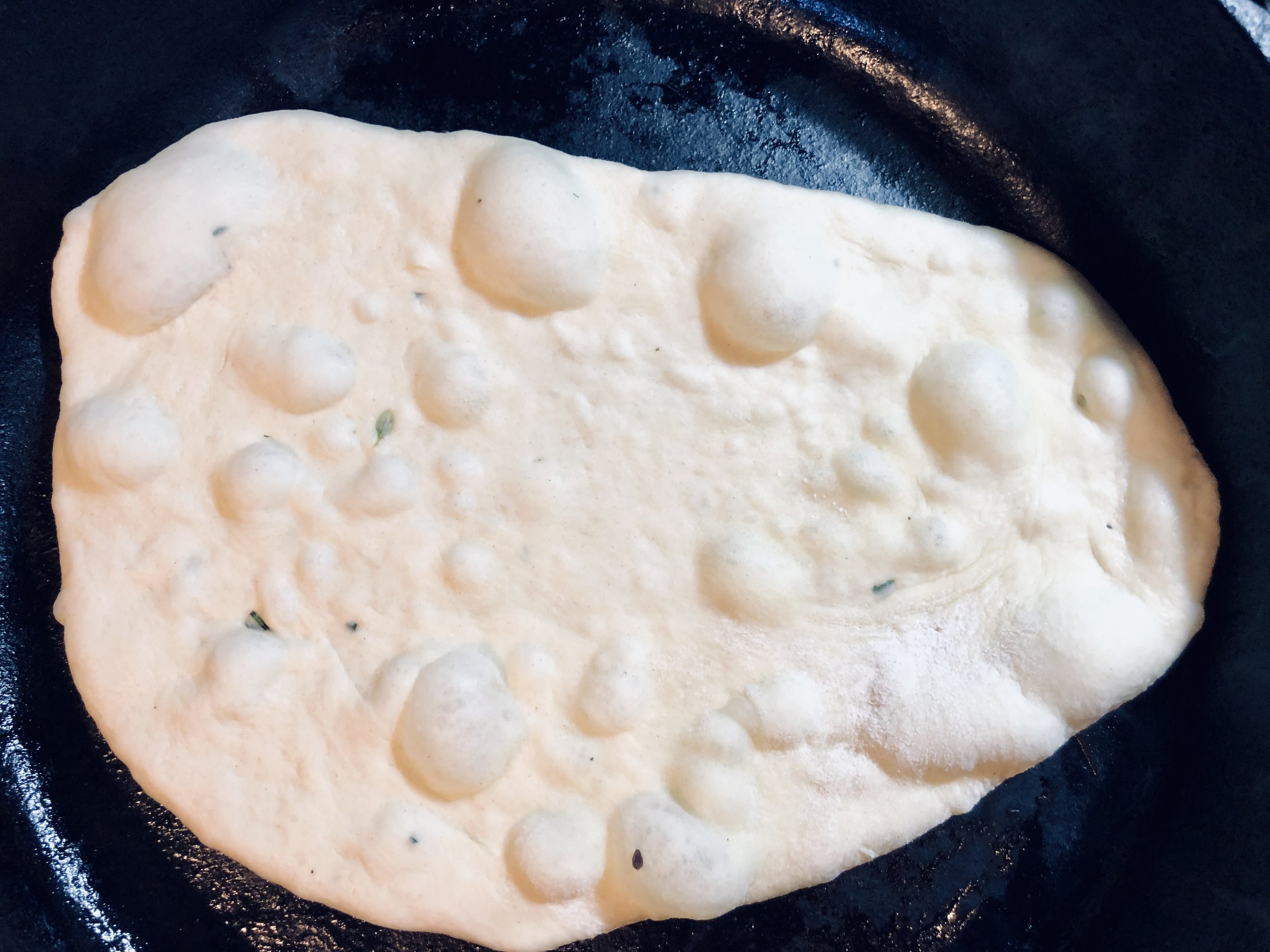 Grill in a hot cast iron pan until it bubbles… then flip!