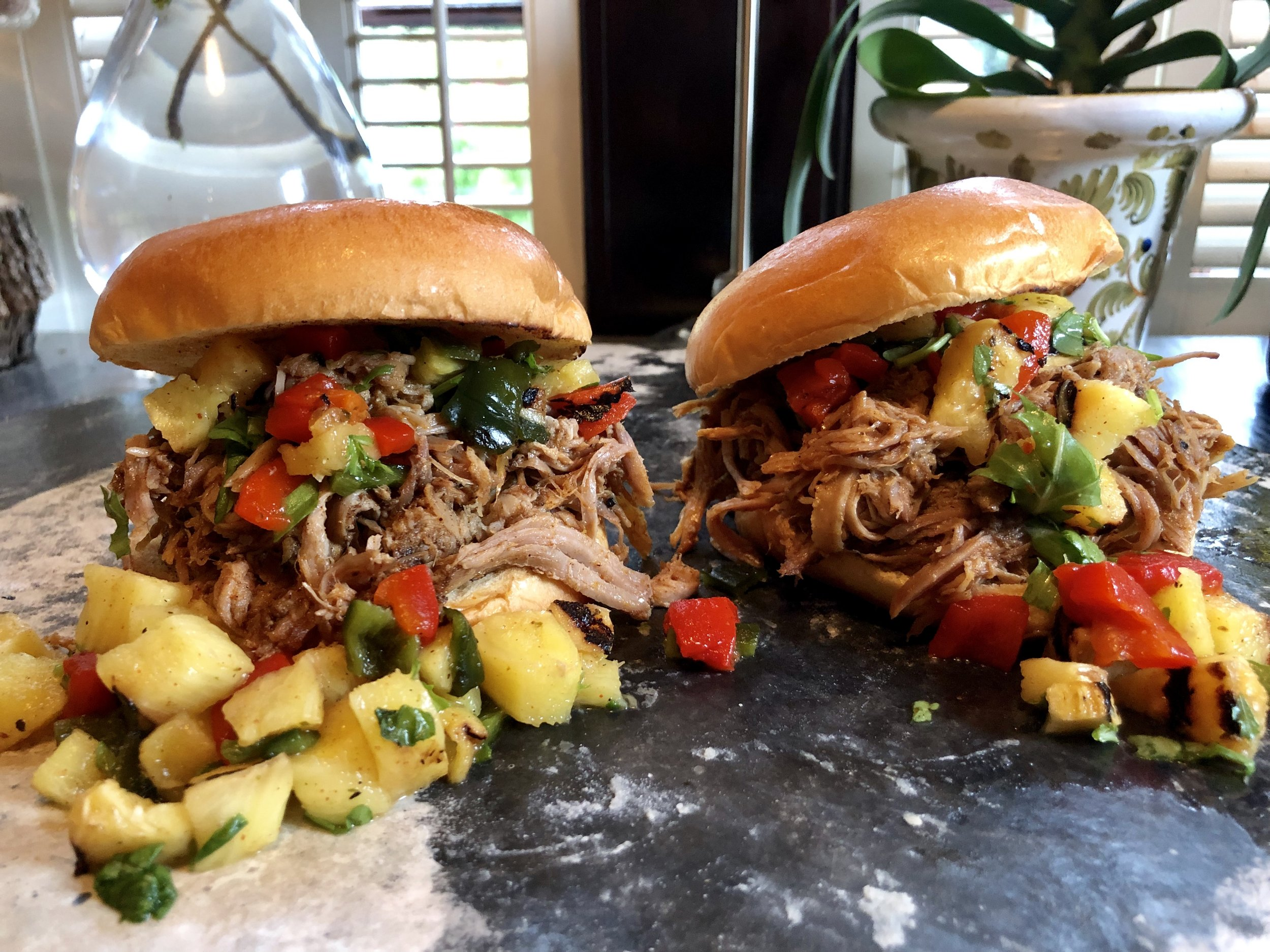 Chop up grilled pineapple, roasted Poblano and Red Chilis, cilantro, and fresh orange juice for a vibrant topping to your shredded pork sandwiches.