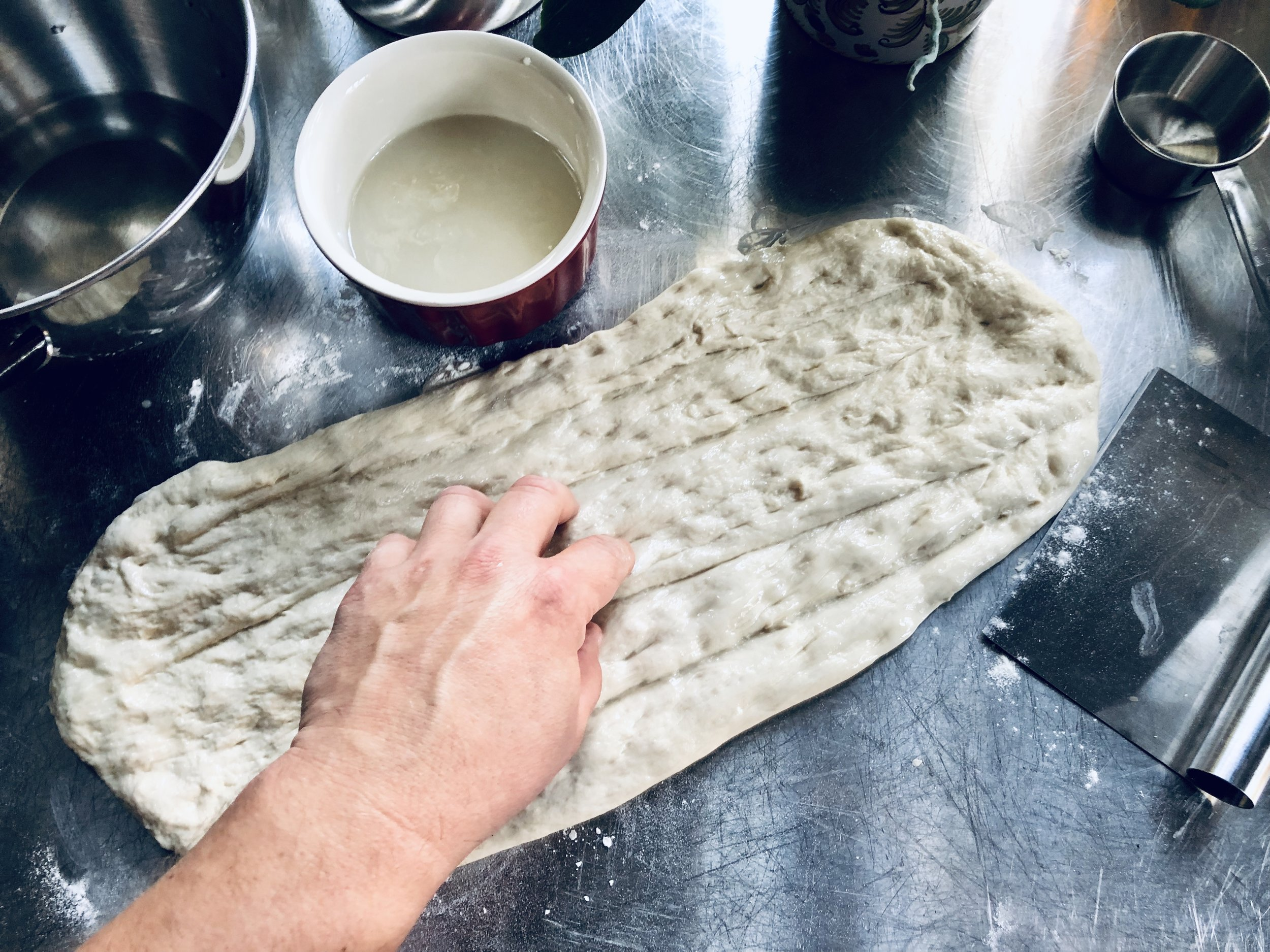 Your hands and fingers are the best tools when making barbari bread!