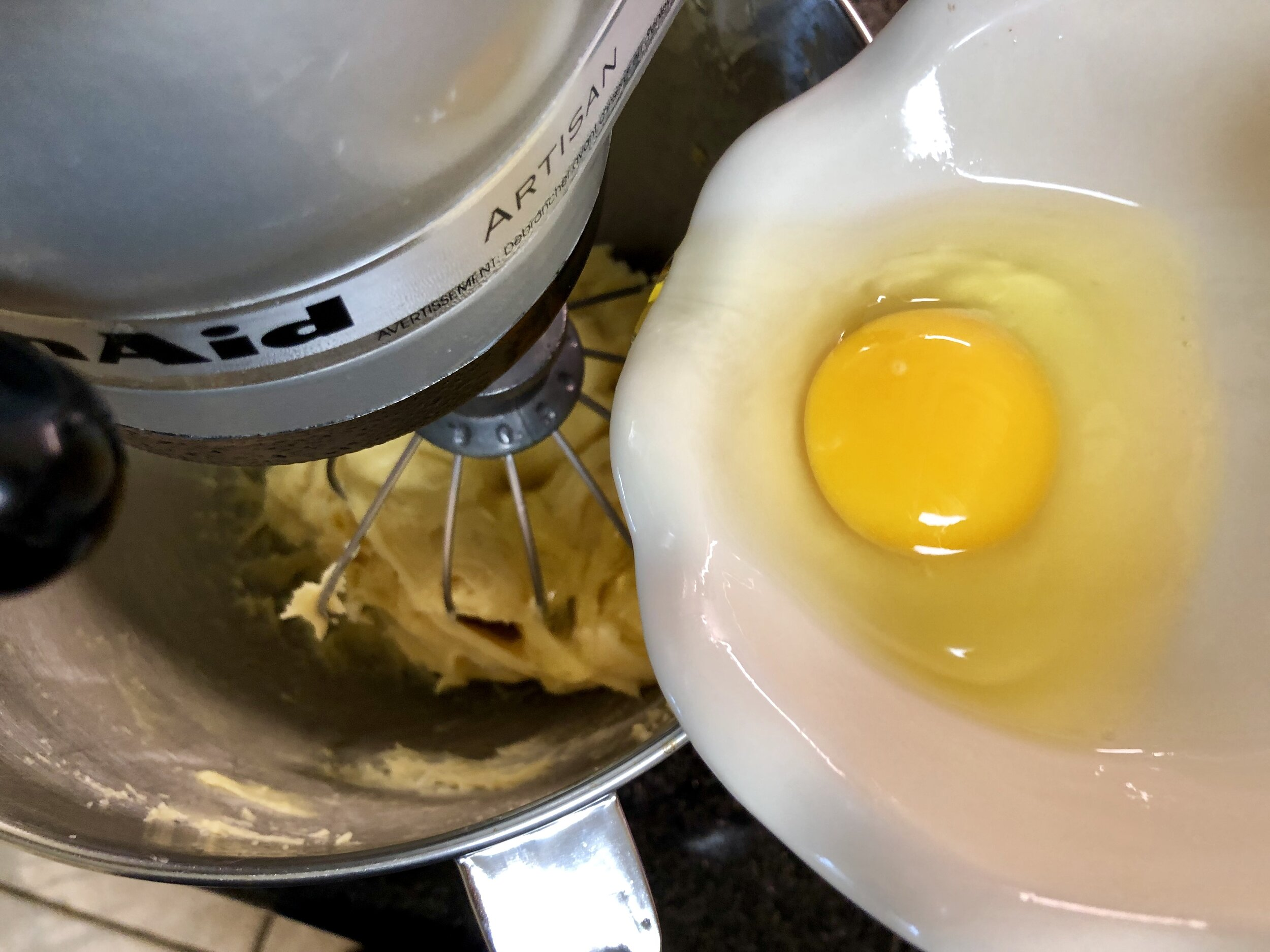 Add the eggs one at a time and mix until smooth.