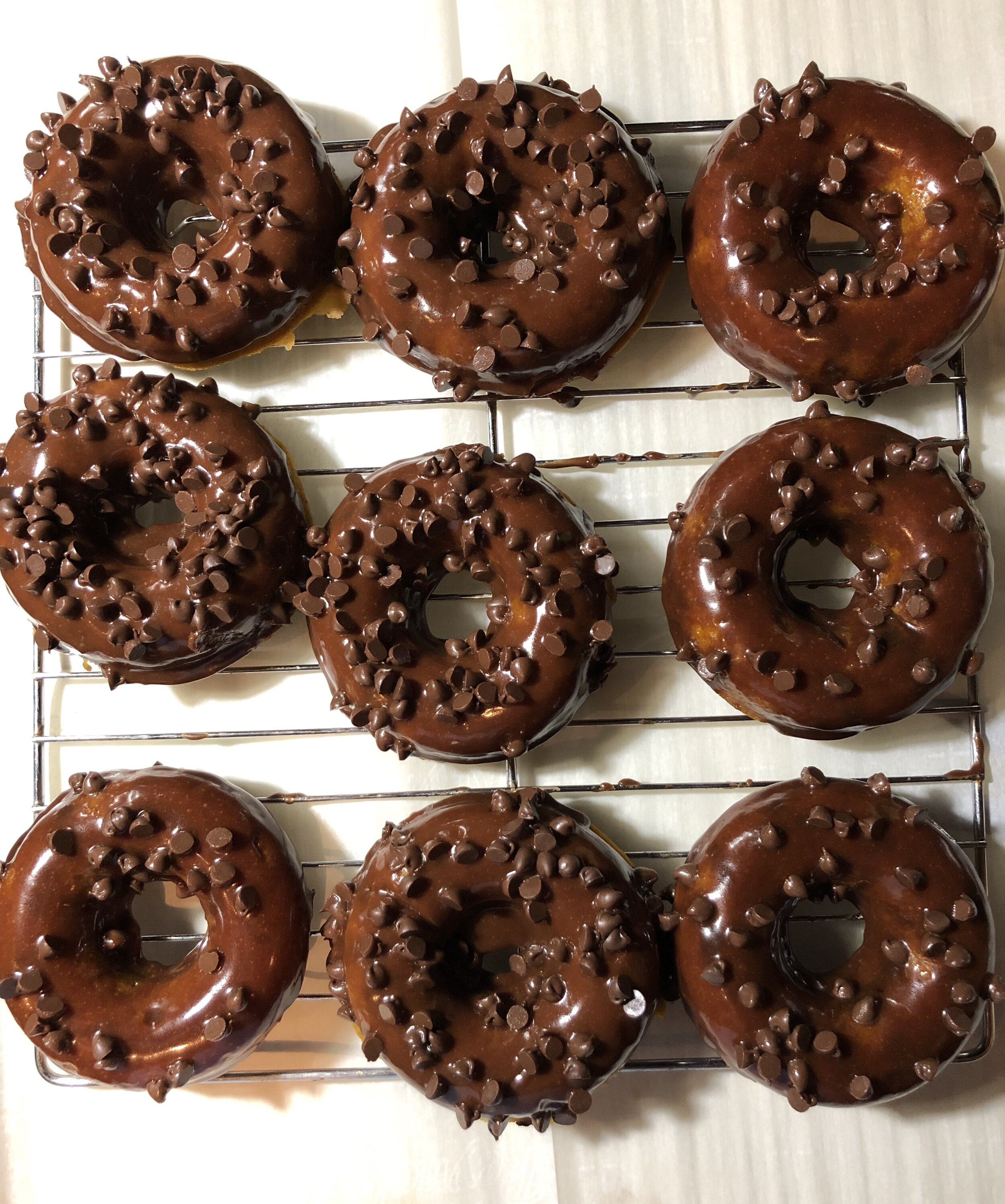 Pumpkin Chocolate-Chip Baked Donuts coated in a Chocolate Bourbon Glaze