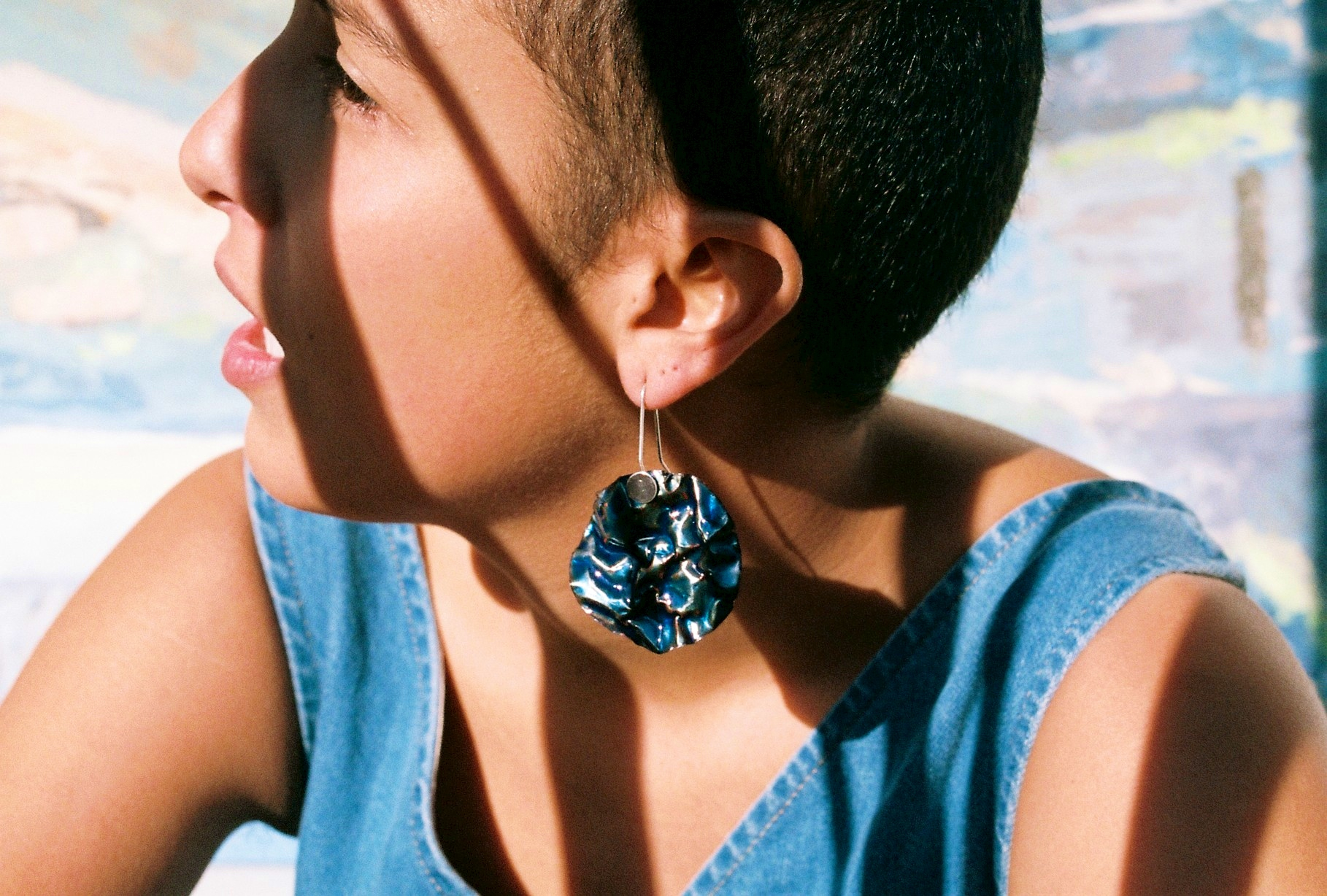 Oil slick earrings. Statement earrings made from sterling silver and enamel. Handcrafted by contemporary jeweller, Ada Hodgson in her Melbourne based workshop.