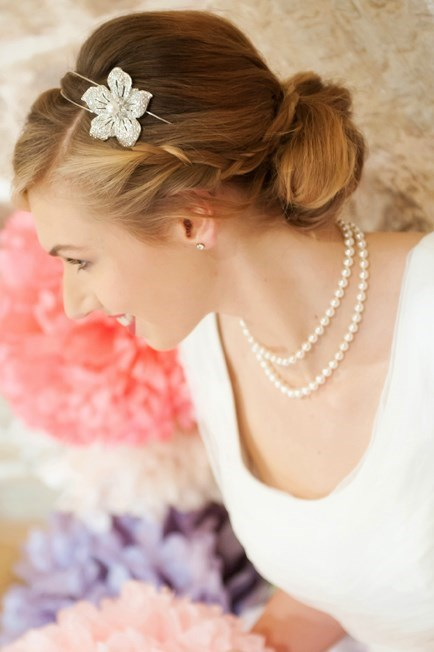 Plaited, relaxed bun with vintage make-up