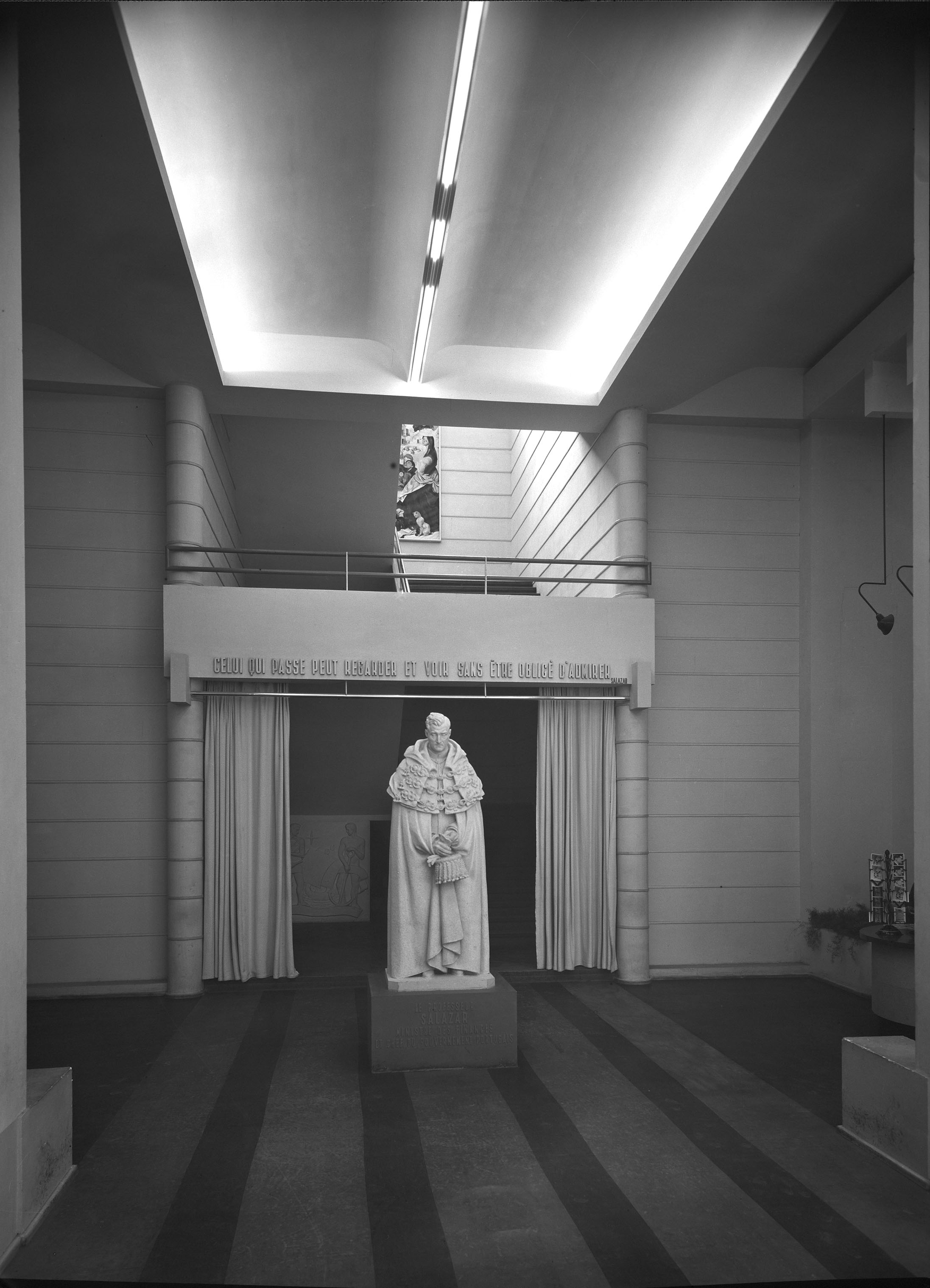Salazar wears academic robes in this statue by Francisco Franco, exhibited in the main foyer of the Portugal Pavilion, Paris International Exhibition, 1937. It was also displayed at the 1940 Exposition of the Portuguese-Speaking World in tandem with a statue of Óscar Carmona by Leopoldo de Almeida,  one of the architects of the Monument of Discoveries.  Photo: Mário Novais, 1937, Paris  Biblioteca de Arte da Fundação Calouste Gulbenkian [CFT003_102354]