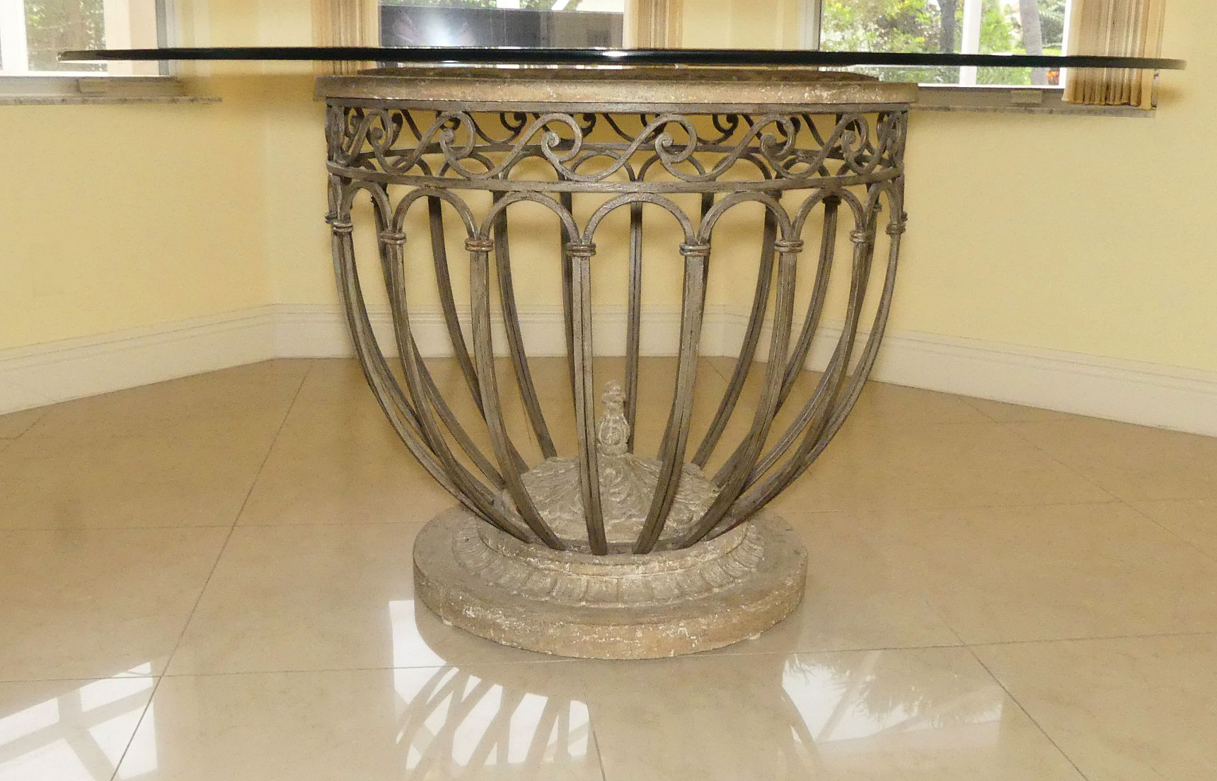 SOLD Glass Top Scrolled Iron and Cast Stone Pedestal Dining Table