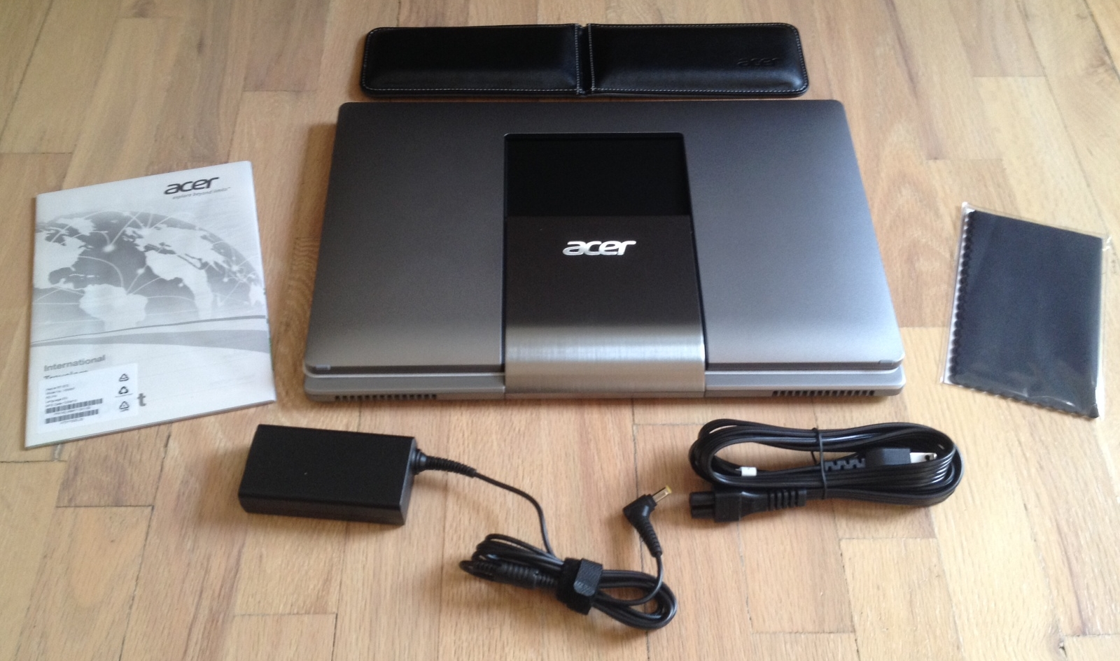 Inside the box is the Acer with prominent silver Ezel hinge, a keyboard palm rest, power supply and cord, cleaning cloth and manual.