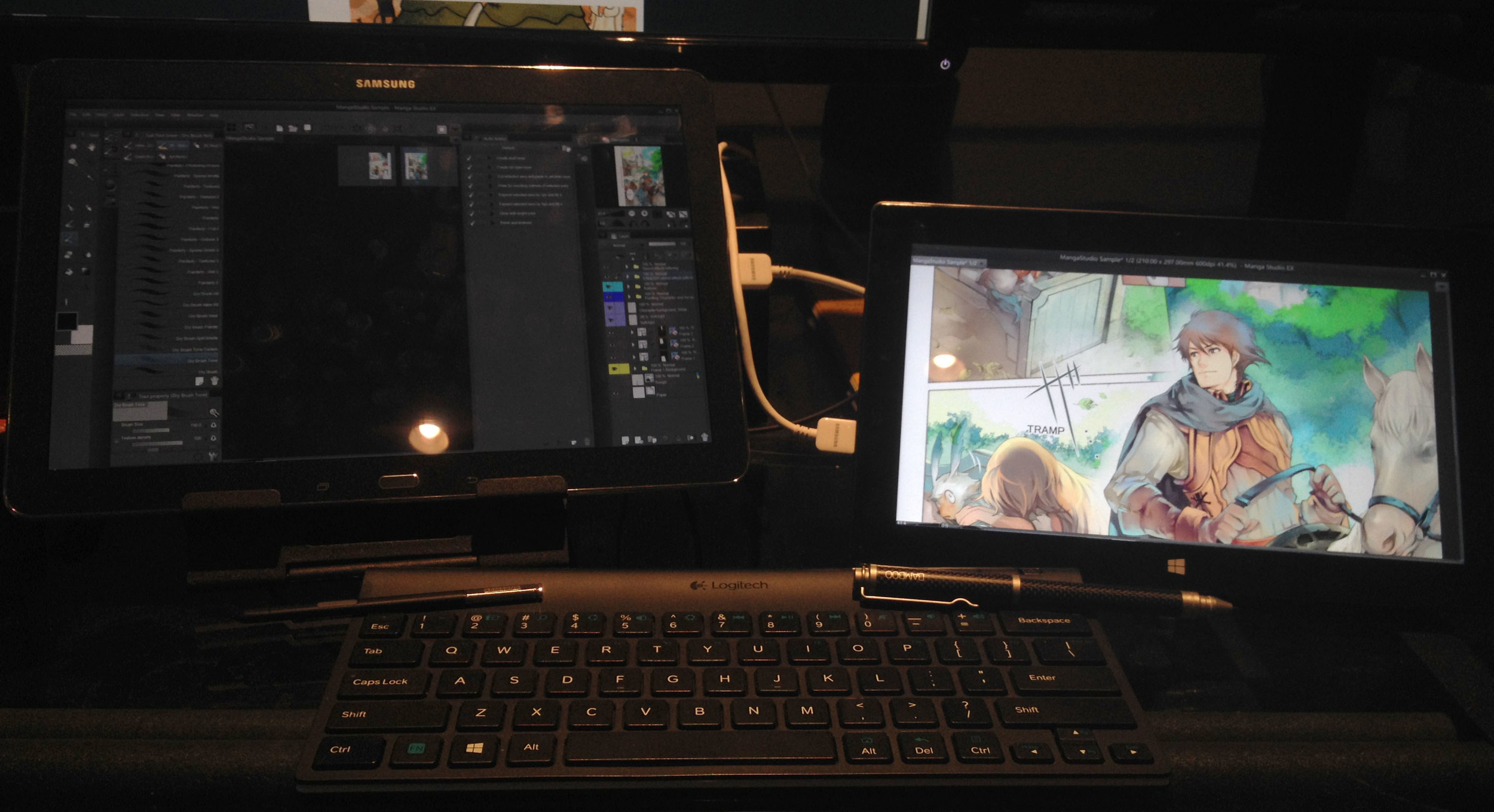 Manga Studio 5.0.4 running on the Surface Pro 2 (right) with the program's UI displayed on the Samsung Galaxy Note Pro 12.2, a bit of technical razzle dazzle made possible by the Android app TwoMonUSB and its desktop server software.