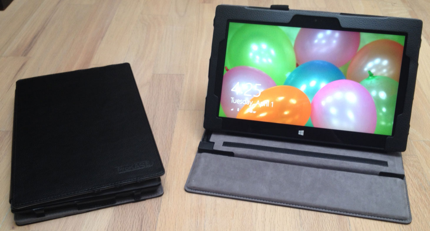 The closed ProKASE on the left with the thin cover and the open case with dock cover. The support is firm enough that it's possible to draw on the Surface Pro screen at this angle.