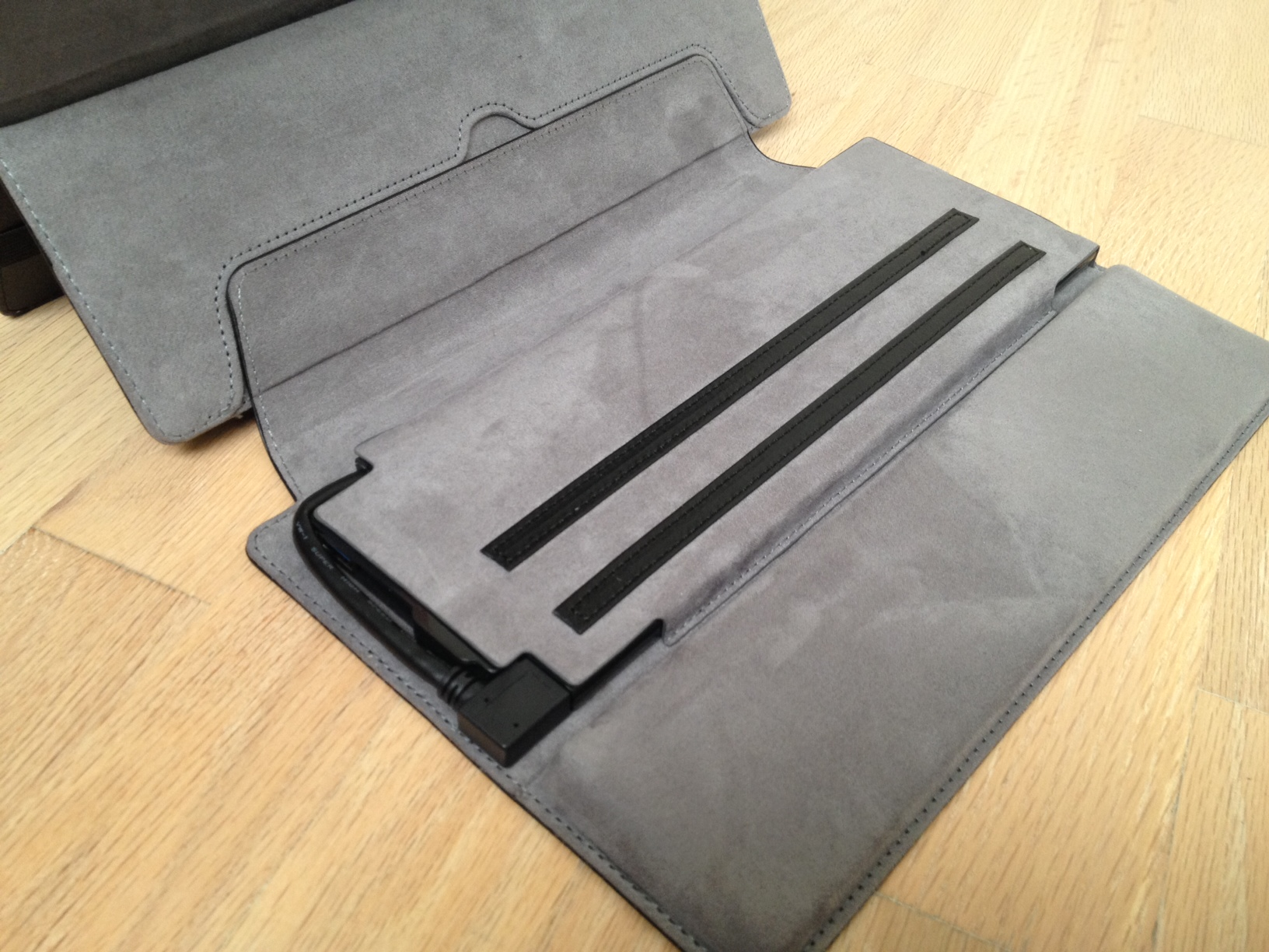 The dock cover sacrifices one of the stopping strips for a padded palm rest. When it's not connected to the Surface Pro, the connector cable on the left side of the dock cover is tucked safely out of the way. Pulling the cable out of its housing can take some effort.