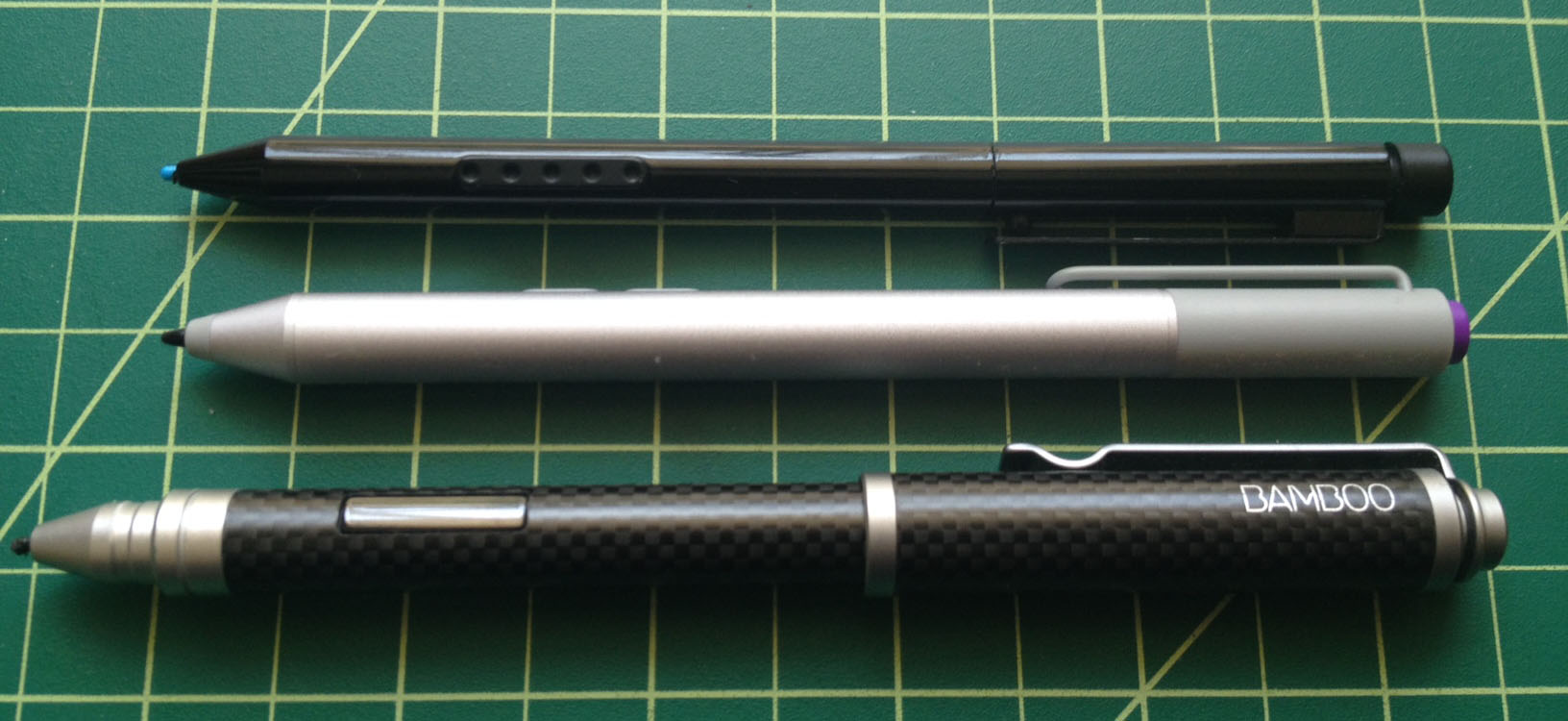 The new pen is the same length as the current Surface Pro stylus, but it is slightly wider and the required AAAA battery adds nice weight. The Wacom Bamboo Feel Stylus - Carbon is much longer with its cap on. The Bamboo's weight tends to tip toward the cap, whereas the weight of the new Surface pen feels nicely balanced.
