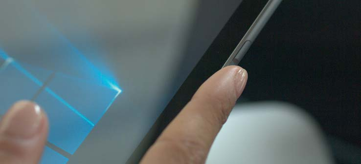 A fingerprint scanner is located between the volume up and down buttons.
