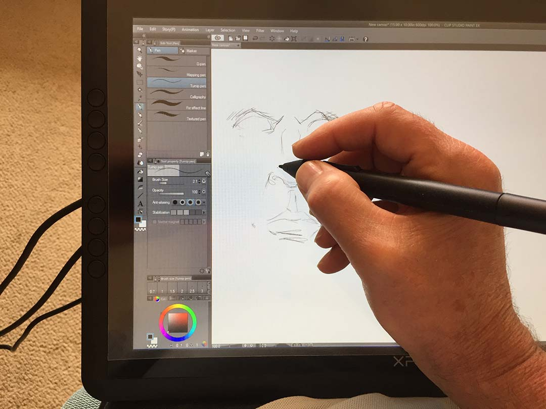 The Artist 16 begs to be taken off its desktop stand and used on the lap. Three cables connect precariously off the left side of the tablet.