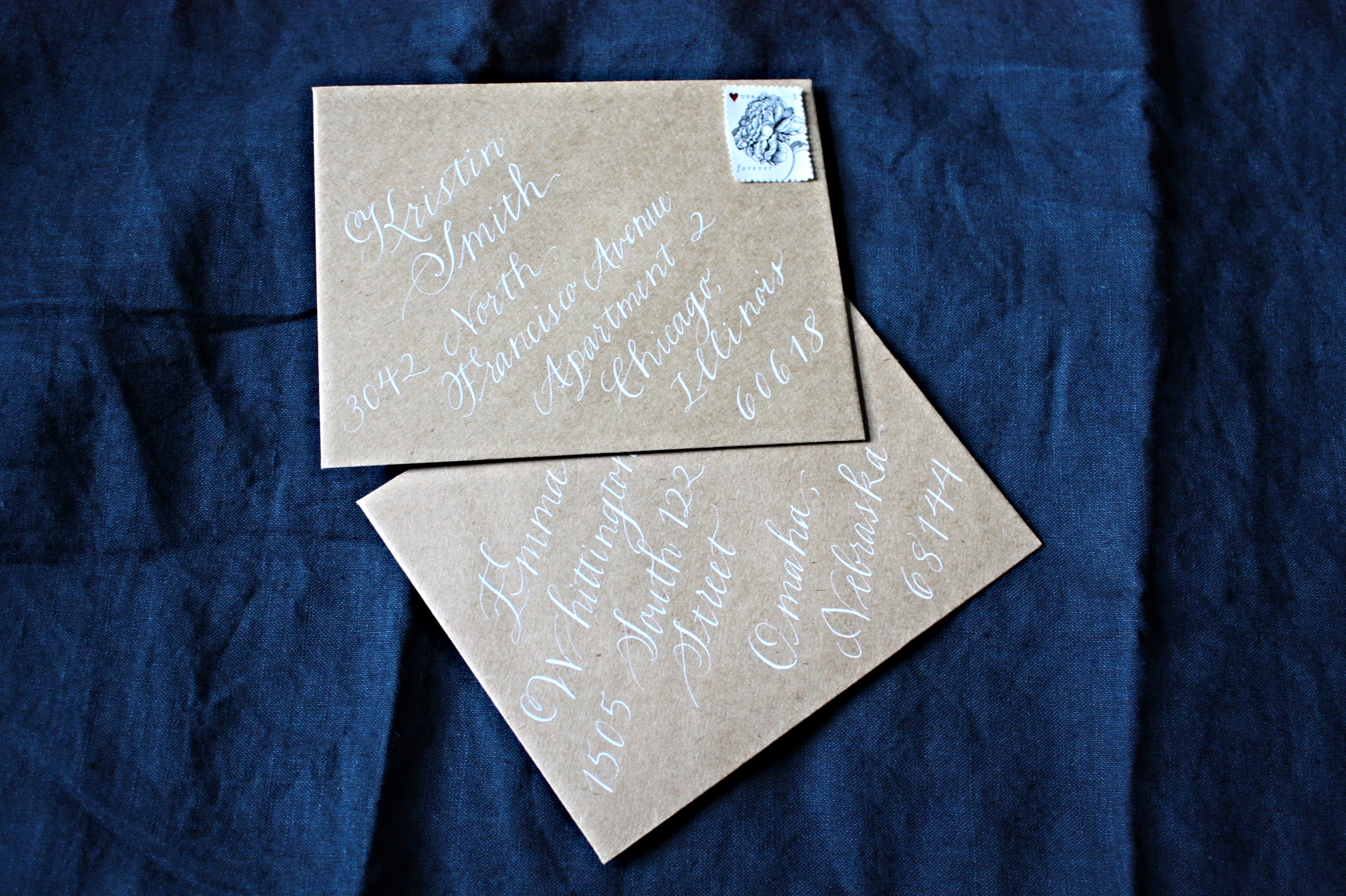 Bluestocking Calligraphy / Bloom style on kraft paper with white ink