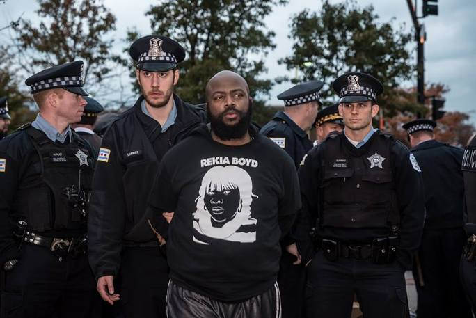 Sarah-Ji of loveandstrugglephotos.com, Timothy Bradford arrested while protesting at the International Association of Chiefs of Police Conference in Chicago on October 24, 2015