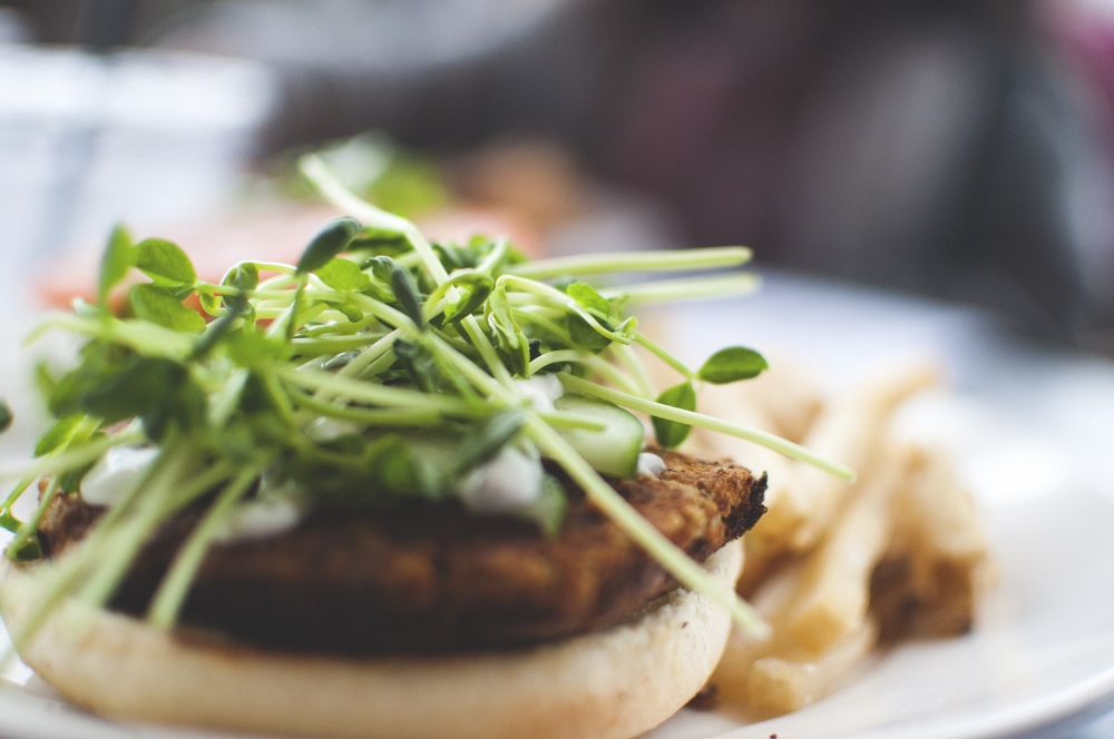 my delicious garden burger with sprouts and hummus.