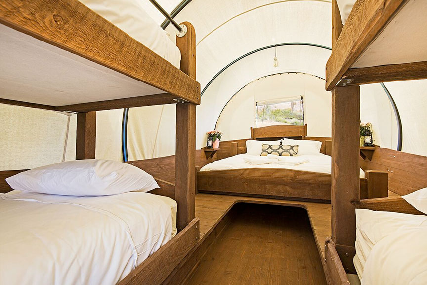 Get a cozy night sleep in a covered wagon - this one sleeps 6!