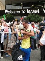 Click photo to download. Caption: Jamie McIntyre is embraced by her Israeli boyfriend Ishai after arriving in Israel. Credit: Courtesy Jamie McIntyre.