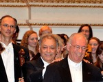 Click photo to download. Caption: Israeli men of music Zubin Mehta (center) and Noam Sheriff (right), on stage at Carnegie Hall in New York following the gala concert of the Israel Philharmonic Orchestra. Credit: Maxine Dovere.
