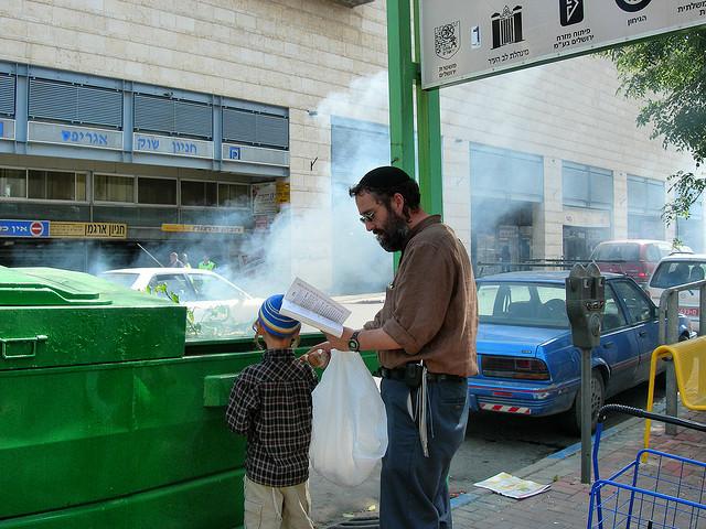 Burning chametz on a Jerusalem street on the eve of Passover. Credit: Judy Lash Balint.