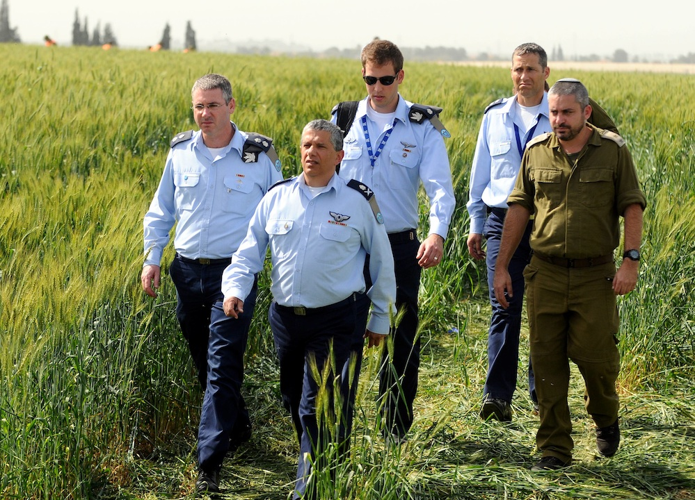 Click photo to download. Caption:Israel Air Force Commander Major General Amir Eshel (front) investigating the accident in which two Air Force pilots were killed in an Israeli military helicopter crash in the Revadim area south of Gedera on Tuesday, March 12. Credit: Yossi Zeliger/Flash90
