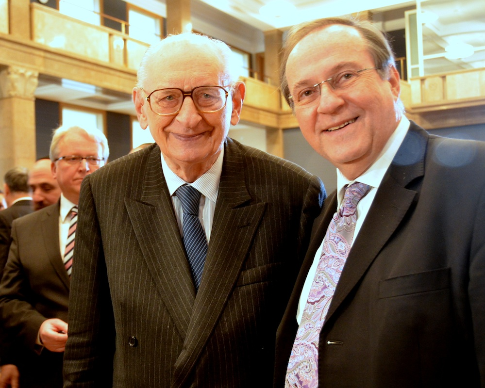 Left to right, 91-year-old Wladyslaw Bartoszewski, one of the founders of the Polish Council to Aid Jews, on Dec. 4 in Warsaw with Israel's ambassador to Poland, H. E. Zvi Rav-Ner. Credit: Maxine Dovere.