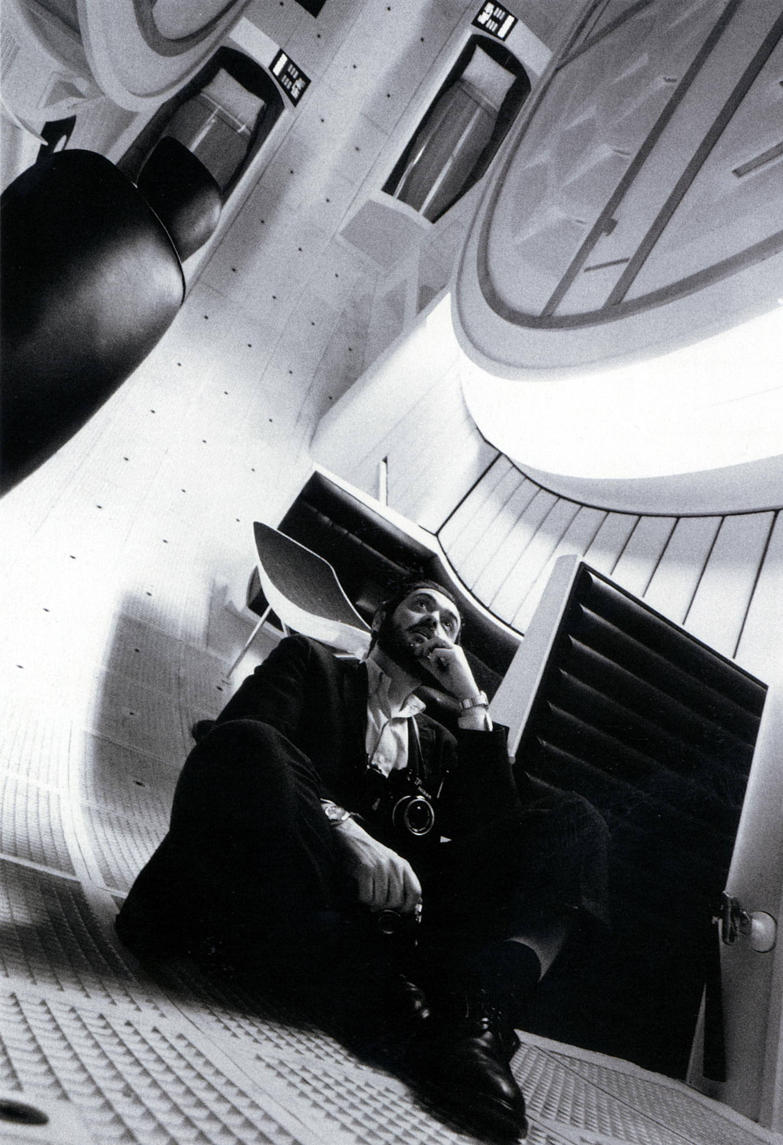 """Click photo to download. Caption: Stanley Kubrick inside the space ship """"Discovery"""" on the set of """"2001: A Space Odyssey."""" Credit: Warner Bros. Entertainment, Inc."""