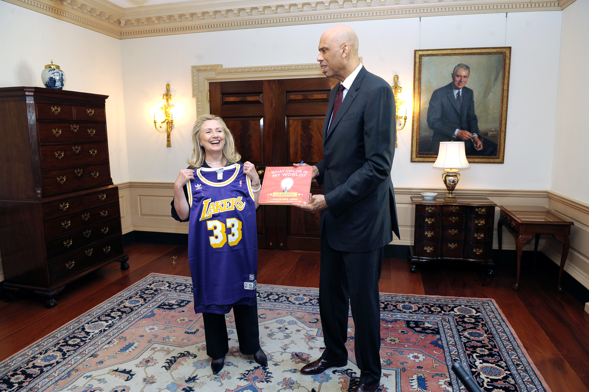 """Click photo to download. Caption:U.S. Secretary of State Hillary Rodham Clinton meets with Hall-of-Famer Kareem Abdul-Jabbar, the NBA's All-Time Leading Scorer and a New York Times' best-selling author, to discuss his new role as a global Cultural Ambassador, at the U.S. Department of State in Washington, D.C., on January 18, 2012. Abdul-Jabbar is holding a copy of the book that earned him a 2013 NAACP Image Award, """"What Color is My World?"""" Credit: U.S. State Department."""