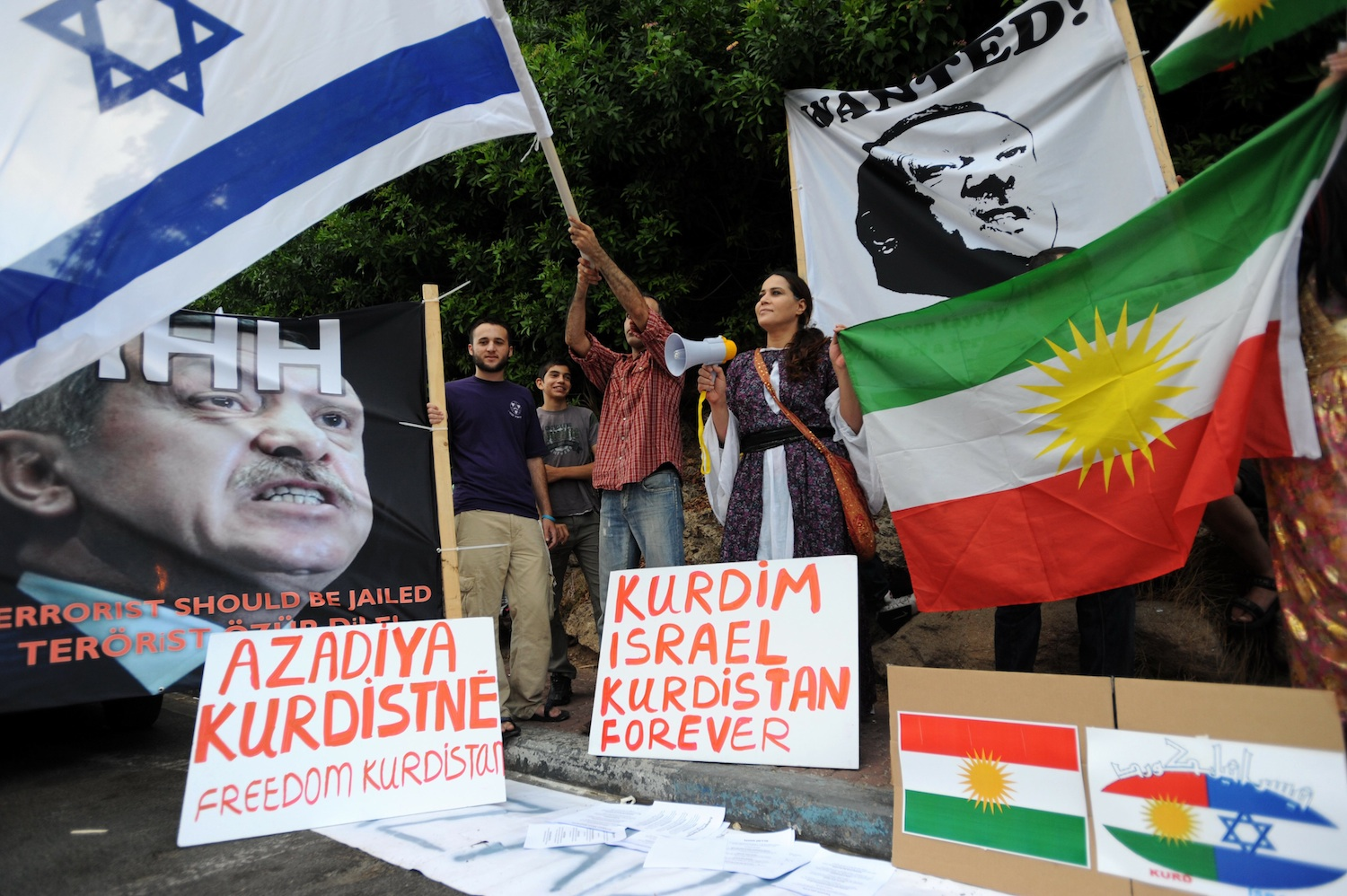 Click photo to download. Caption:Israelis hold up placards, including a portrait of Turkey's Prime Minister Recep Tayyip Erdoganlabeled wanted, during an anti-Turkish protest outside the Turkish embassy in Tel Aviv on July 8, 2010. Credit:Gili Yaari/Flash 90.