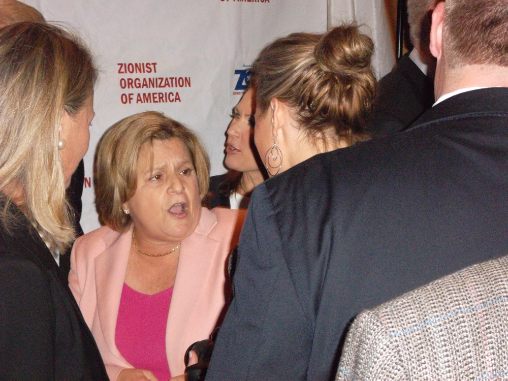 Click photo to download. Caption: U.S. Rep. Ileana Ros-Lehtinen of Florida mingles with attendees at Sunday night's Zionist Organization of America gala in New York City. Credit: Jacob Kamaras.