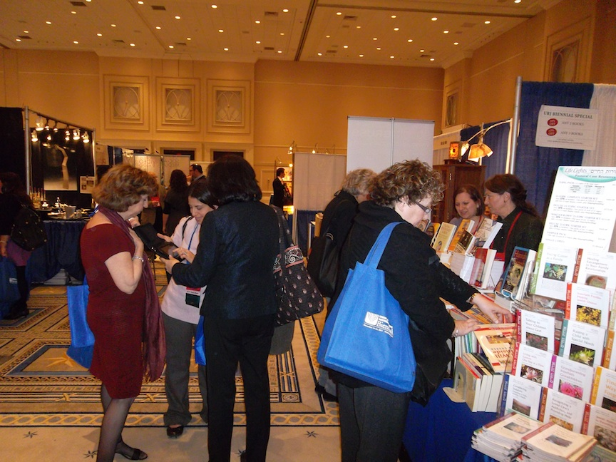 Click photo to download. Caption: The exhibit hall at the Union for Reform Judaism biennial convention. Credit: Jacob Kamaras.