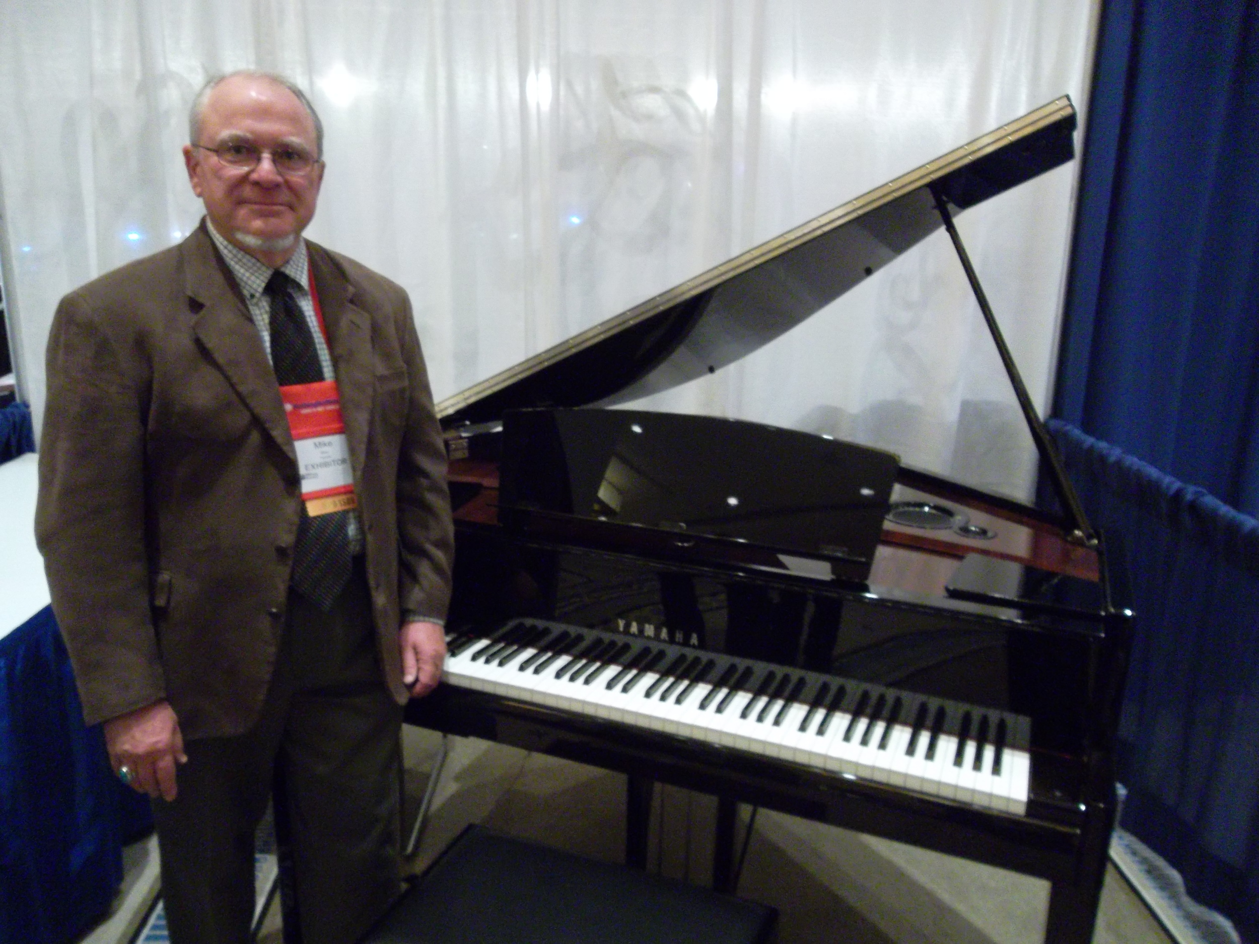 Click photo to download. Caption: Mike Bates came to the Union for Reform Judaism to make synagogues aware of the AvantGrand piano. Credit: Jacob Kamaras.