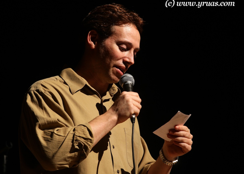 """Click photo to download. Caption: Comedian Avi Liberman performs at a """"Comedy for Koby"""" show. Credit: Yissachar Ruas."""