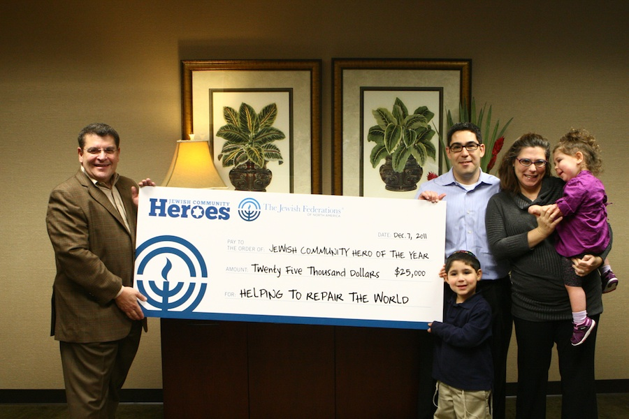 Click photo to download. Caption: Randy Gold and his family -- Caroline, Eden and Natanel -- receive Randy's $25,000 Heroes grant for the work of Atlanta Jewish Gene Screen. Credit: Jewish Federation of Greater Atlanta.