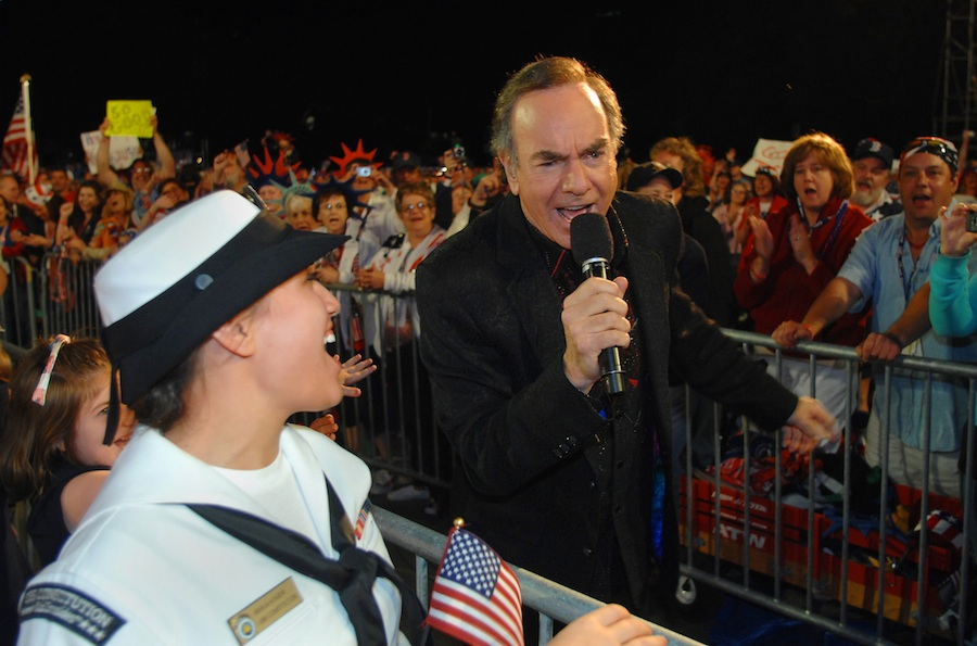 "Click photo to download. Caption: Mass Communication Specialist 3rd Class Anna Kiner sings ""Sweet Caroline"" with Neil Diamond during Boston's nationally televised 4th of July concert. Credit: U.S. Navy"