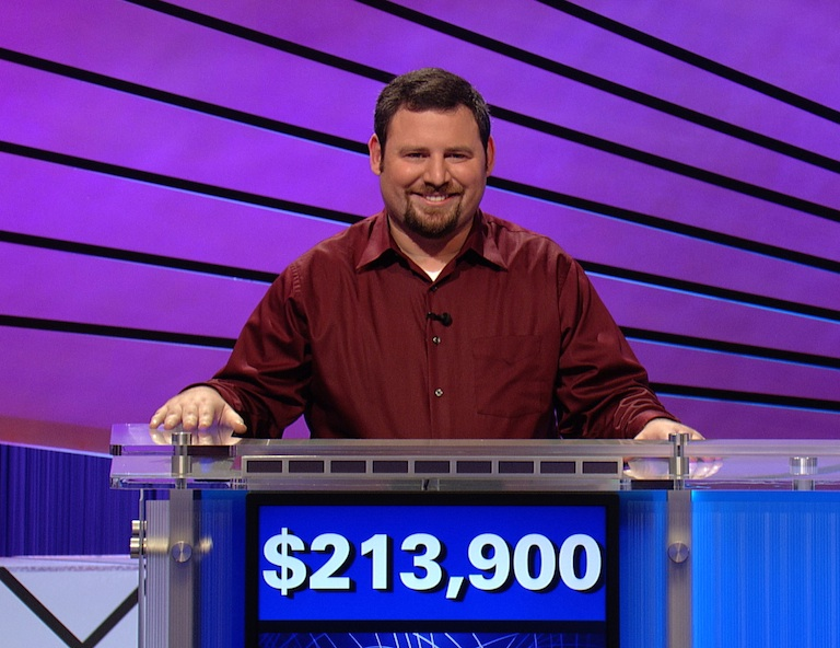 Click photo to download. Caption: Jason Keller poses with his final winnings over nine episodes on Jeopardy!—$213,900. Credit: Courtesy of Jeopardy!