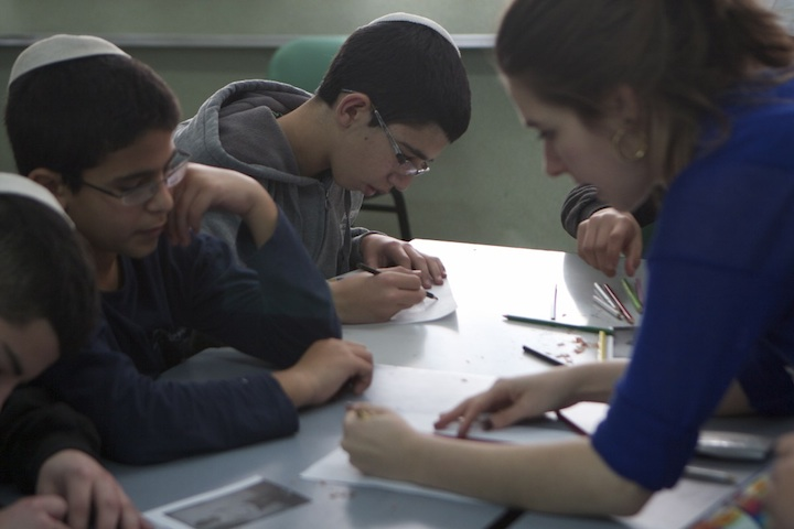 Click photo to download. Caption: A Stern College students works with Israeli children. Credit: Courtesy of Yeshiva University.