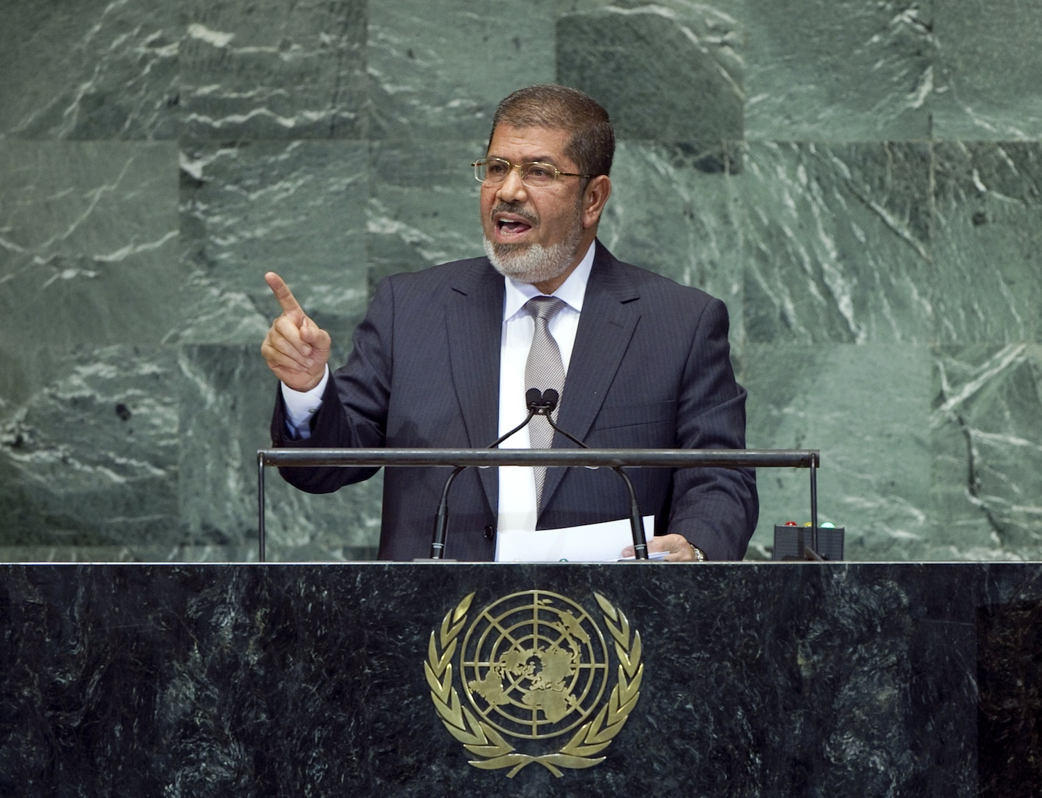 Click photo to download. Caption: Egyptian President Mohamed Morsi, seen speaking to the United Nations General Assembly, on Sept. 26, 2012, is overseeing a country with growing religious violence, particularly against Coptic Christians. Credit:UN Photo/Marco Castro.