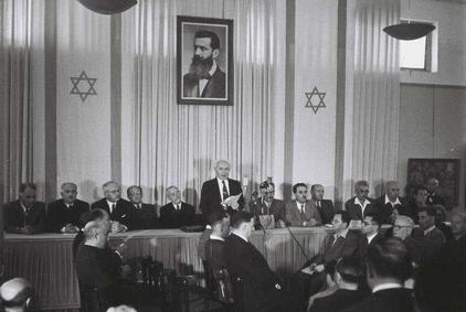 Click photo to download. Caption: David Ben Gurion reading the declaration of the Independence of Israel in the Tel Aviv Museum, 1948. Credit: State of Israel National Photo Collection.