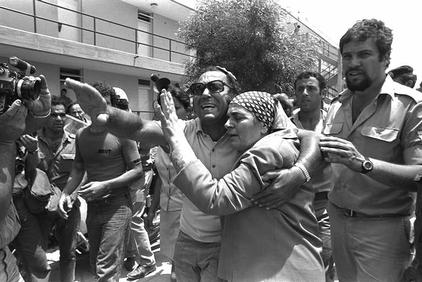 Click photo to download. Caption: An emotional family reunion after the return of hijacked Air France passengers from Entebbe. Credit: State of Israel National Photo Collection.