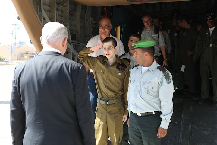Click photo to download. Caption: Gilad Shalit salutes Prime Minister Benjamin Netanyahu upon his return to Israel from Hamas captivity. Credit: IDF Spokesperson's Unit.
