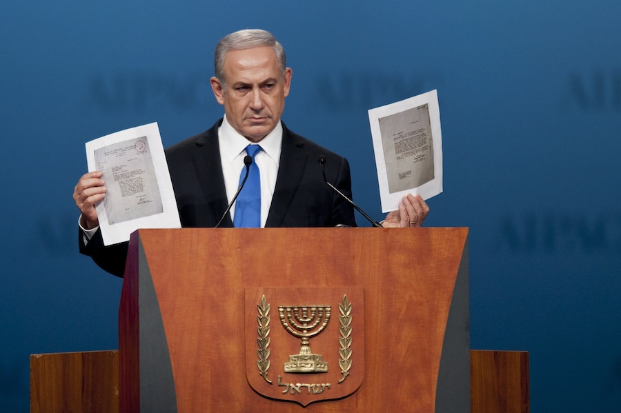 Click photo to download. During his Monday night speech at the AIPAC policy conference, Prime Minister Benjamin Netanyahu holds up a copy of letters from 1944, in which the World Jewish Congress had implored the American government to bomb Auschwitz. Credit: EPA/PETE MAROVICH.