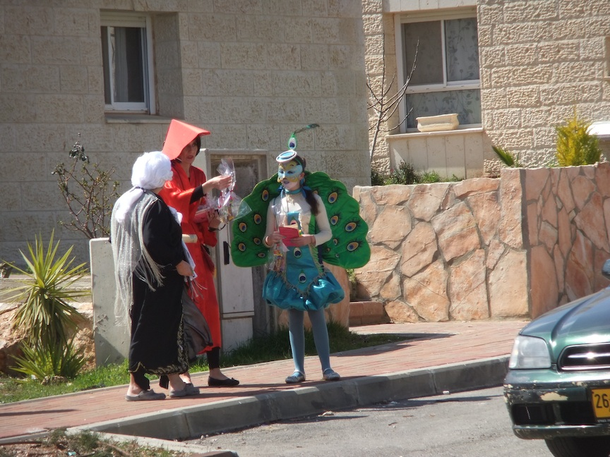 Click photo to download. Caption: Purim in the Israeli city of Ofra. Credit: PD.