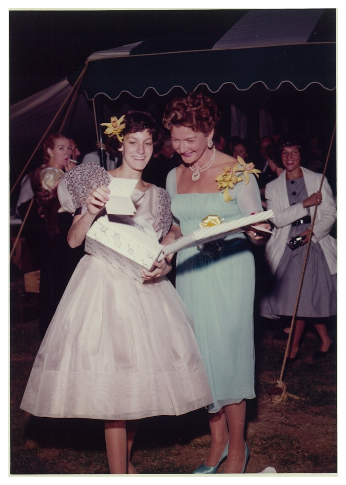 Click photo to download. Caption: Judith Ginsberg and Adele Wall Ginsberg, open Judith's bat mitzvah gifts in Larchmont, New York, on September 19, 1959. Credit: Courtesy of Judith Ginsberg.