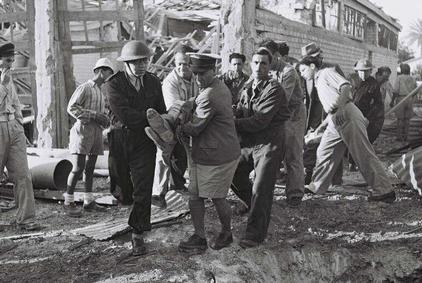Click photo to download. Caption: Volunteers and Haganah members evacuate a man wounded by the Egyptian bombardment of Tel Aviv during the 1948 War of Independence. Credit: State of Israel National Photo Collection.