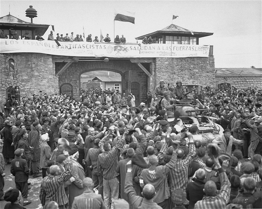 Click photo to download. Caption: Survivors of the Mauthausen concentration camp cheer the soldiers of the Eleventh Armored Division of the U.S. Third Army one day after their actual liberation in May 1945. Credit: National Archives and Records Administration.