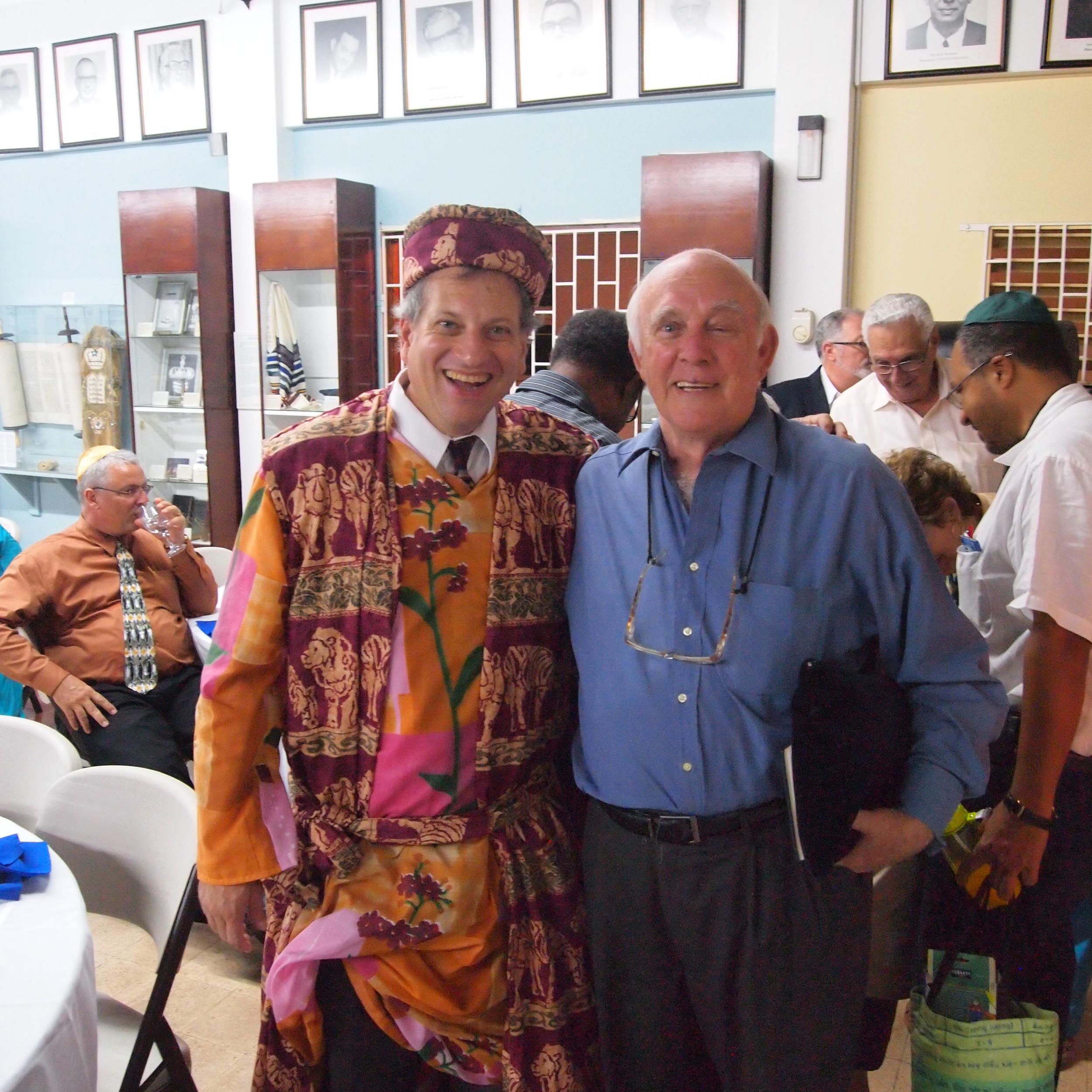 Click photo to download. Caption: Rabbi Dana Evans Kaplan (left, dressed as Elijah) with Jewish community historian Ainsley Henriques on Passover in Kingston, Jamaica. Credit: Courtesy Rabbi Dana Evans Kaplan.
